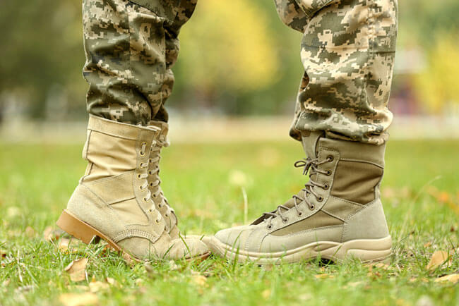 Military couple on sunny day in park