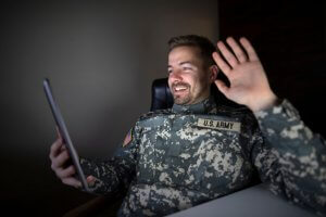 soldier in USA military uniform in front of the computer